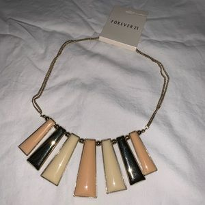 Gold and nude color statement necklace